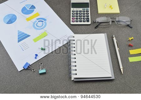 Pen, Book, Calculator, Glasses And Financial Chart And Graph