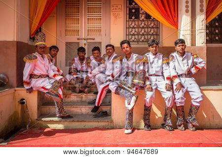 GODWAR REGION, INDIA - 15 FEBRUARY 2015: Wedding ceremony band members relax after practice.