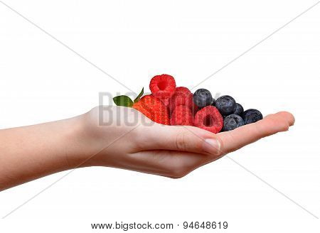 Strawberry with blueberries and raspberries in hand