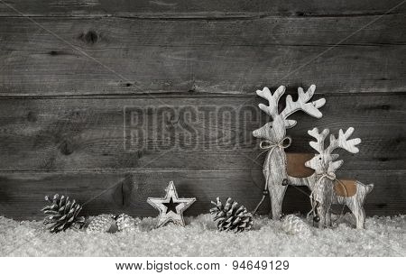 Wooden christmas background in shabby chic style in grey and white with reindeer.