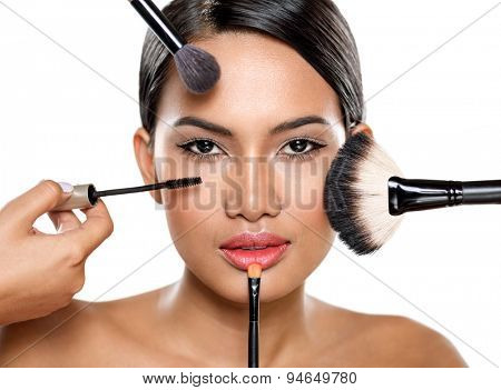 beautiful woman with make-up brushes near attractive face, makeup, cosmetic,  applying make-up