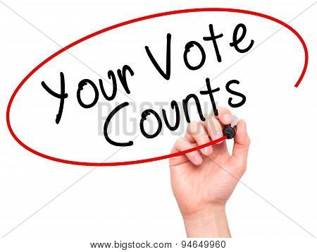 Man Hand writing Your Vote Counts with black marker on visual screen.