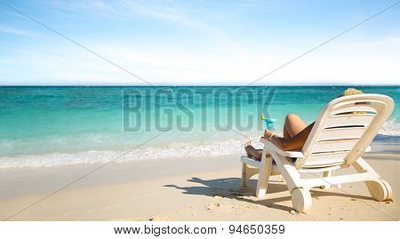 Luxury female sunbathing on the beach, enjoying beautiful seascape, summer travel and tourism concept
