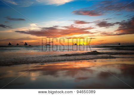 Tropical beach at beautiful colorful sunset