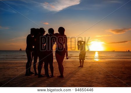 summer vacation, group of people photographing by camera on beach