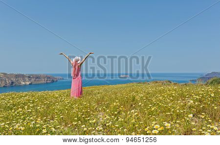Woman In A Long Summer Dress  On The Beach Sea.