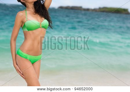 Attractive female body with modern bikini, sea in background