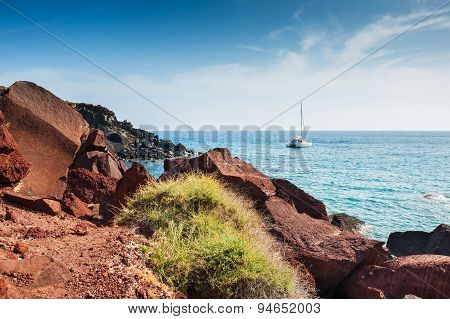 Beautiful Red Beach With Turquoise Water And Big Stones