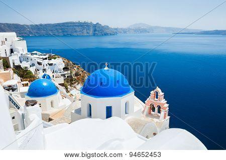 Church With Blue Domes In Oia Town, Santorini Island, Greece