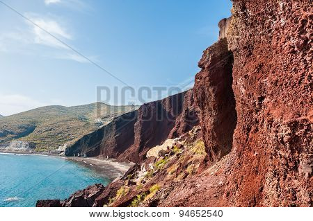 Beautiful Red Beach With Turquoise Water And Big Rocks