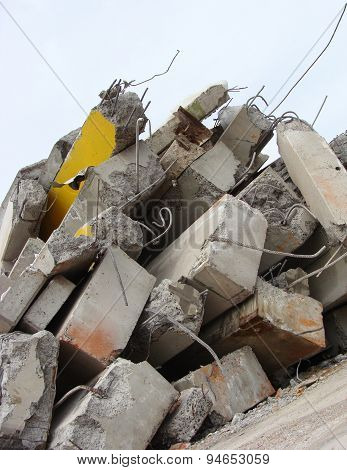 Large Concrete Chunks With Twisted Metal On A Demolition Site