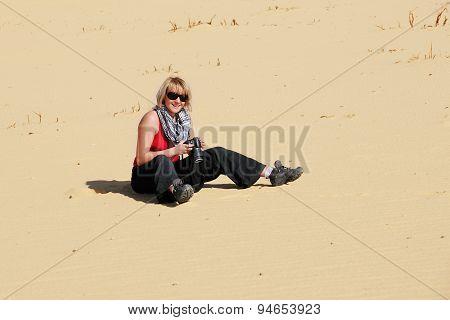 Tourist Girl In Desert