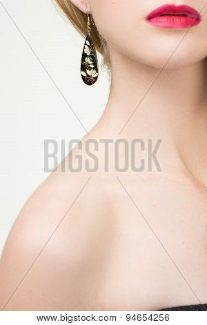 close up of woman wearing shiny diamond earrings
