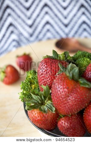 Strawberry In Bowl With Broccoli