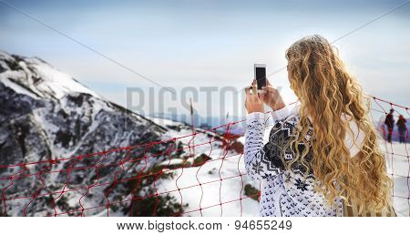 Woman Photographing Winter Landscape Mountains And Snow With Cell Phone