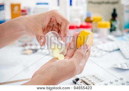 pharmacist holding medicine container