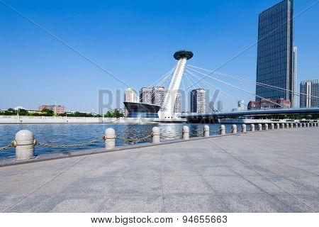 Tianjin, China-May 22, 2015:modern buildings in urban city tianjin at riverbank.