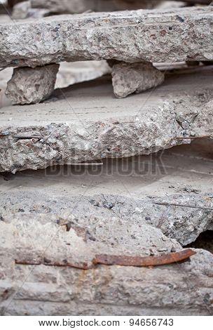 Close-up photo of a pile broken concrete blocks
