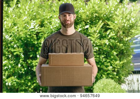 Handsome Delivery Man With Two Cardboard Boxes
