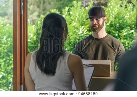Woman Accepting A Delivery Of Two Cardboard Boxes