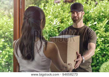 Deliveryman Making A Door To Door Delivery