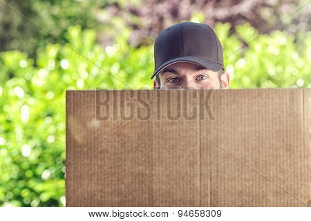 Man Delivering A Large Cardboard Box