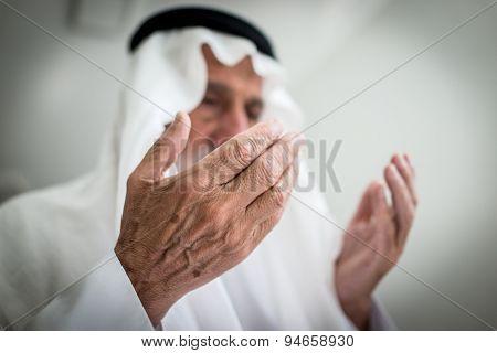 Elderly Muslim Arabic man praying
