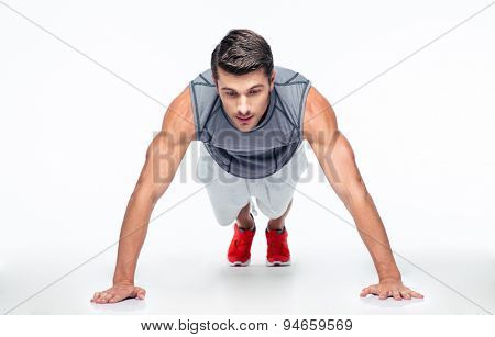 Fitness man doing push ups isolated on a white background