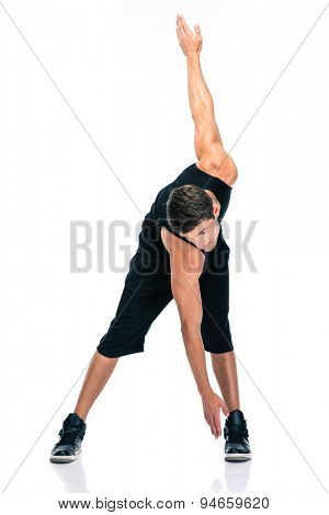 Full length portrait of a fitness man doing exercises for warm up isolated on a white background
