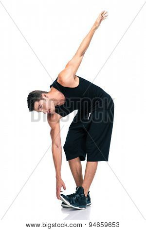 Sports man doing exercises for warm up isolated on a white background
