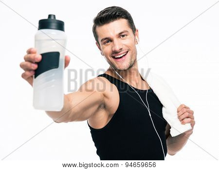 Smiling fitness man holding towel and bottle with water isolated on a white background