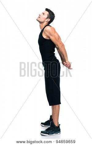 Side view portrait of a fitness man stretching hands isolated on a white background