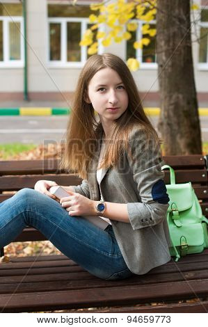 Student Sitting On Bench