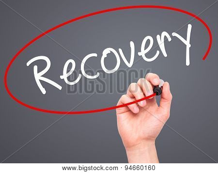 Man Hand writing Recovery with black marker on visual screen