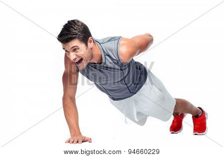 Fitness young man doing push ups with one hand isolated on a white background