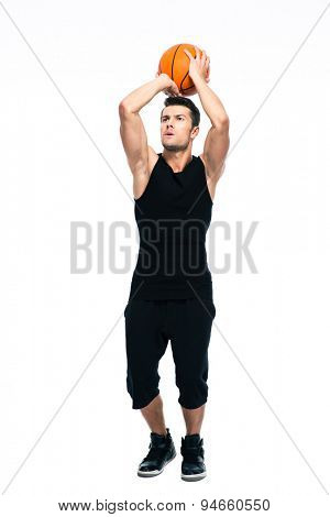 Portrait of a sports man playing in basketball isolated on a white background