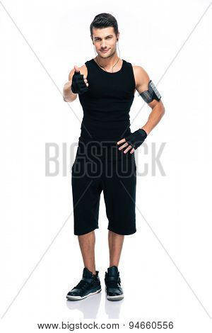 Full length portrait of a sports man showing thumb up isolated on a white background