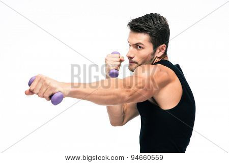Sports man working out with small dumbbells isolated on a white background