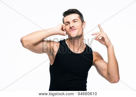 Handsome man listening music in headphones isolated on a white background