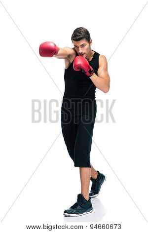 Full length portrait of a sports man boxing in red gloves isolated on a white background