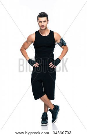 Full length portrait of a confident fitness man standing isolated on a white background. Looking at camera