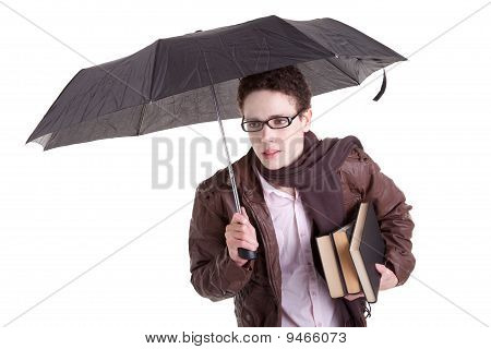 Young Boy With An Umbrella Carrying Books, Isolated On White, Studio Shot