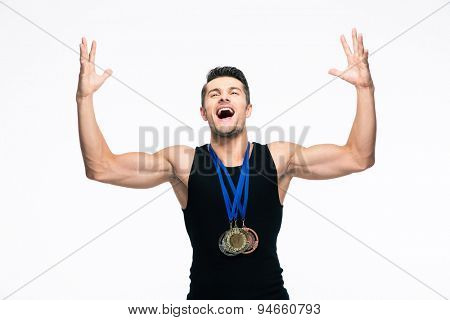 Fitness cheerful man with medals celebrating his success isolated on a white background