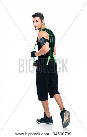 Full length portrait of handsome man with skipping rope isolated on a white background