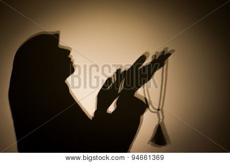 Silhouette of Muslim woman with hijab
