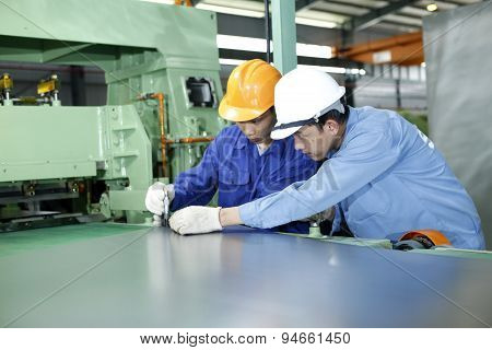 Ha Noi Vietnam - OCtober 29 2012: Two workers are working in a mechanical workshop