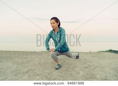 Woman Workout On Coast In The Morning