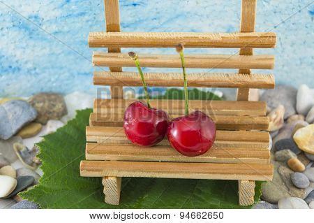 Two Cherries On A Miniature Bench