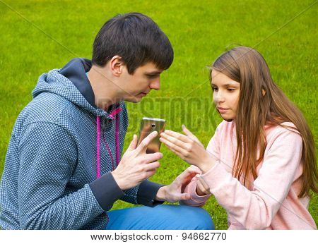 Brother and sister with phone