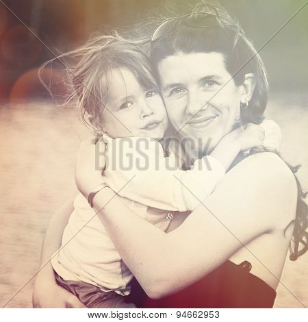 Mother and Little girl sharing a hug with instagram effect